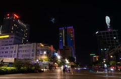 Vietnam Skyline (axxonlive) Tags: city longexposure nightphotography travel light monument night landscape neon sony country structure vietnam saigon hochiminh lightroom travelandlife nex5t