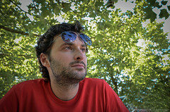 gazing (Alexandra Tsiam) Tags: trees summer portrait man reflection tree green glasses daylight spring day looking greece thinking gazing sunnyday ioannina mansportrait