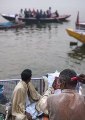Boats At Dasaswamedh Ghat On Ganges River, Varanasi, India (Eric Lafforgue) Tags: morning people india water vertical architecture river outdoors photography bath asia day religion tranquility transportation varanasi spirituality rearview hinduism cultures comb ganga ganges banaras benares ghat veranasi gangesriver uttarpradesh traditionalclothing realpeople traveldestinations colorimage smallgroupofpeople indianculture highangleview colourimage indiansubcontinent floatingonwater builtstructure nauticalvessel sacredcity indianethnicity incidentalpeople gangasevanidhi indianethnicit eth0992