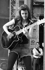 performers on the Mile 0204 (byronv2) Tags: bw musician music woman white black sexy girl monochrome scotland edinburgh legs guitar fringe royalmile shorts performer oldtown guitarist whiteblack edinburghfestivalfringe jeansshorts deminshorts fringe2013