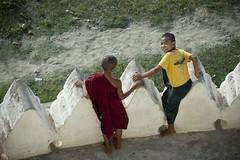 MM028 Boys at play - Bagan (VesperTokyo) Tags: boy green smiling yellow children child burma monk barefoot myanmar paya burmese pagan bagan darkred longyi shavenhead bupaya novicemonk myanmarese