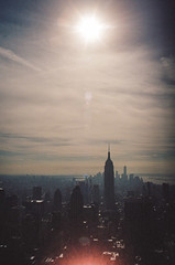 (Donstahl) Tags: newyorkcity sun newyork skyline cityscape minolta rockefellercenter lensflare empirestatebuilding portra xd11 topoftherock