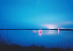 night lights (Max Nathan) Tags: longexposure blue red england black film night boat norfolk wells flare nightsky ricoh buoy wellsnextthesea portra400 ricohgr1s