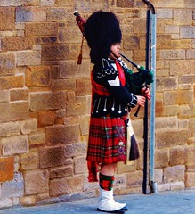 The tradition shall be kept alive (pics.ferr) Tags: street red people music polaroid scotland edinburgh bagpipes tradition polaroidis2132
