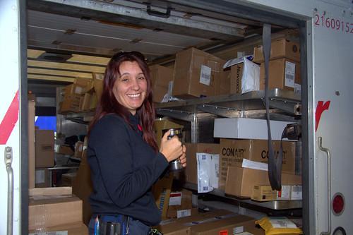 Female Working Inside Truck / Travailleuse dans un camion