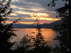 Darkness Rolling Over West Coast (Shutterbuglette) Tags: ocean pink sea mountains water vancouver evening coast pretty peach explore shore evergreens inlet stanleypark graceful nightfall westvancouver coastalmountains daysend beautifulevening springsunset prettysunset inexplore westcoastsunset comingdarkness beautifulcitiesoftheworld shutterbuglette peachysunset
