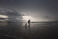 (briyen) Tags: sunset dog beach fishing long icm palawan roxas 2016