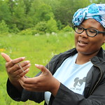 A student checks out a garter snake during a field trip to Schenck Forest.