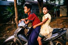 Girl on the bike (Guille Ibanez) Tags: girl fuji buddha burma buddhism parade motorbike motorcycle fujifilm myanmar burmese tanaka monywa