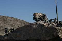 A U.S. Army Soldier assigned to Bravo troop, 1st squadron, 14th Cavalry Regiment, 1st Brigade Combat Team, 2nd Infantry Division, observes the area for enemy contact during Decisive Action Rotation 16-06 at the National Training Center in Fort Irwin, Cali (Operations Group, National Training Center) Tags: california usa soldiers stryker fortirwin ftirwin nationaltrainingcenter 2ndinfantrydivision 1stbrigadecombatteam bravotroop 1stsquadron 14thcavalryregiment ntc1606