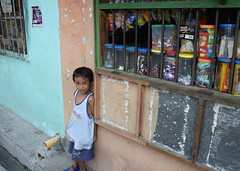 Wise beyond his years (pommypaul) Tags: poverty look kids philippines streetphotography earthy manila ochre sarisari