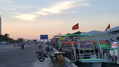 Ready to cruise (Roving I) Tags: lighting tourism boats evening sunsets flags vietnam cruises lifejackets danang wharves motorscooters hangiang