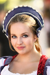 Princess With a Slightly Mischievous Grin (wyojones) Tags: texas texasrenaissancefestival toddmission texasrenfest renfest renfaire renaissancefaire faire renaissancefestival festival trf girl woman brunette maiden wench cute pretty lovely gorgeous beautiful beauty blueeyes smile lips redlips princess blondehighlights
