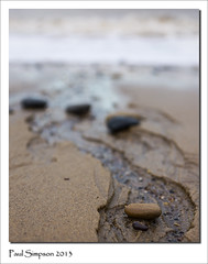 Flowing back to sea (Paul Simpson Photography) Tags: uk beach water coast seaside sand pattern stones patterns pebbles coastal pebblebeach northeast eastcoast watercourse eastyorkshire hornsea eastridingofyorkshire eastriding photosof imageof photoof tracksinthesand imagesof sonya77 september2013 paulsimpsonphotography
