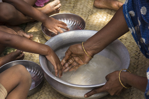 Getting ready for a midday meal, Rangpur, Bangladesh. Photo by Holly Holmes, 2013.