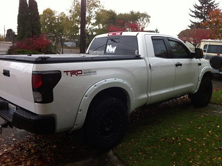 Black Folding Truck Bed Cover on White Toyota Tundra