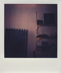 View From A Tired Nineteen Year Old's Bed (Evan Joseph Fusco) Tags: old polaroid frames bed year books tired heater shelves nineteen