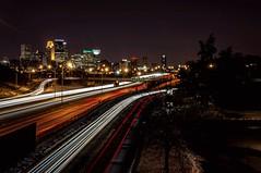Fastlane (Doug Wallick) Tags: road minnesota skyline long exposure minneapolis overpass pedestrian interstate 394 lightroom frontage a55