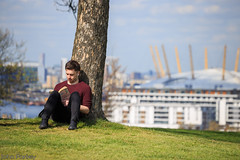 Relaxing in the spring sunshine (John Parfrey) Tags: england tree london reading book unitedkingdom bokeh relaxing read milleniumdome greenwichpark theperksofbeingawallflower o2arena