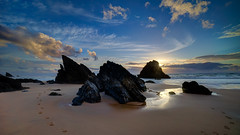 Hard rocks (Joo Cruz Santos) Tags: sunset seascape beach portugal landscape sintra footprints a7 adraga pnsc ndgradreverse sel1018