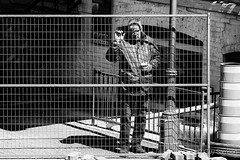 Man watching men at work (guysamsonphoto) Tags: bw victoriaville victo niksilverefexpro guysamson sony70200f4 sonyalpha7rmkii