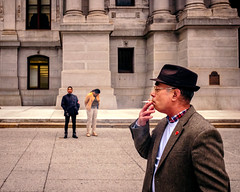 Footloose and Fancy Free (c. Melon Images) Tags: street city urban philadelphia hat fashion fuji candid streetphotography smoking philly 23mm x100s