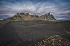 Stokksnes (aevarg) Tags: sunset people mountain black mountains reflection beach water strand landscape coast photo iceland sand nikon bravo outdoor south roadtrip reykjavik atlantic serene horn volcanic landschap hofn austurland hornafjörður austur stokksnes hornafjordur nikond700 stokknes