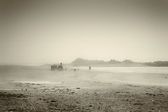 'Sea mist Rhosneigr' (Meurig2011) Tags: tractor beach water sepia lumix seamist anglesey northwales rhosneigr