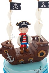 Captain Isaac (Little Cottage Cupcakes) Tags: birthday blue cake canon ship pirate crocodile sail sharks pirateship fondant piratecake pirateshipcake sugarpaste skullsandcrossbones littlecottagecupcakes