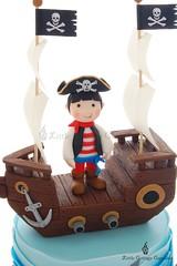Captain Isaac (Little Cottage Cupcakes) Tags: birthday blue cake canon ship pirate crocodile sail sharks pirateship fondant piratecake pirateshipcake sugarpaste skullsandcrossbones littlecottagecupcakes
