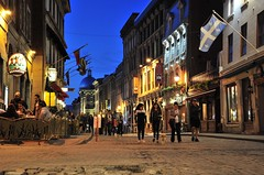 blue hour in Old Montreal (Sharkshock) Tags: road street travel blue canada tourism stone architecture fun montreal flags tourists cobble hour nuit cafes vieux giftshops