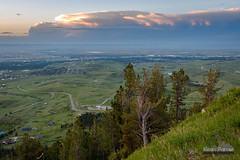 Casper Anvil (kevin-palmer) Tags: caspermountain wyoming june summer sunset evening dusk color colorful sky orange clouds distant thunderstorm cumulonimbus anvil scenic view vista tamron2470mmf28 nikond750 road slope storm stormy
