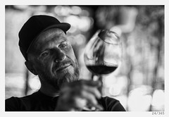Rok the wine ''expert'' (Alja Ani Tuna) Tags: portrait blackandwhite bw man black love glass rock wine year slovenia cap winetasting 24 tasting wineglass nikkor f18 director dop rok d800 thelook 85mmf18 project365 onceaday 24365 nikkor85mm photo365 onephotoaday nikond800