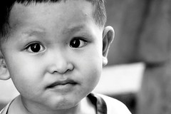 Humble Expression (Electric Shutter) Tags: boy bw white black canon photography photo singapore alone adams emotion quote expression picture orphan vietnam lonely create sg product encourage humble reveal confidence sprit perceptions binhduong 450d