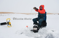 Ice fishing (Scott Little66) Tags: winter lake fish snow canada man cold ice nature water sport yellow season glasses frozen fishing fisherman hole bright hobby gloves rod leisure recreation activity northern success finder tackle scoop icefishing freshwater ladle auger