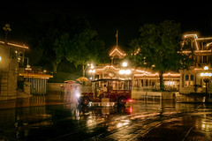 A rainy night on Mainstreet. (janoimagine) Tags: travel reflection fall wet car rain orlando mainstreet florida disney transportation mickeymouse waltdisneyworld canondslr canoneos waltdisney mainstreetusa themagickingdom wetweather waltdisneyworldresort disneyparks waltdisneyimagineering disneyphotography mickeysnotsoscaryhaloweenparty studio2719
