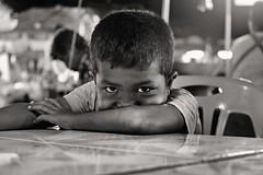 dark eyes (mamuangsuk) Tags: portrait littleboy thaipeople farang suratthani foreigner darkeyes southernthailand nightbazar westerner mamuangsuk fujixe1 suratrestaurant