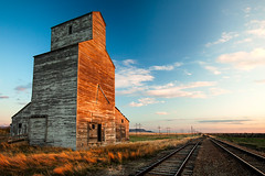 The Last Light at Laredo (www.toddklassy.com) Tags: old railroad summer sky orange usa sunlight plant west building abandoned industry horizontal architecture clouds rural landscape outdoors evening countryside vanishingpoint wooden corn montana warm afternoon mt farm wheat united country rustic ruin harvest tracks bluesky nobody nopeople structure storage bin silo equipment business havre crop transportation stockphotos western tall states prairie copyspace agriculture peelingpaint laredo idyllic greatdepression grainelevator smalltown scenics obsolete granary stockphoto railroadtracks greatplains stockphotography hillcounty highway87 buildingexterior builtstructure economicdecline montanaphotography montanapictures