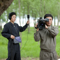 JOURNALISTES NORD COREENS, COREE DU NORD (Eric Lafforgue Photography) Tags: camera trees people color colour work square person concentration asia labor korea headset communism arbres travail micro headphones greenery asie coree personne couleur humanbeing journalism reporters communisme verdure journalists northkorea journalistes casque dprk carre ecouteurs lookingatcamera journalisme colorpicture waistup squarepicture democraticpeoplesrepublicofkorea labeur etrehumain coreedunord rpdc regardantlobjectif republiquepopulairedemocratiquedecoree cadragealataille imagecaree microphophone filmantlobjectif filmingatcamera northkoreantelevision televisionnordcoreenne