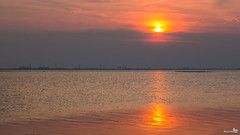 Sunset reflection (BraCom (Bram)) Tags: trees sunset holland reflection clouds canon zonsondergang bomen widescreen nederland thenetherlands windmills 169 zuidholland goereeoverflakkee grevelingen spiegeling windmolens southholland bewolking canonef24105mm herkingen bracom canoneos5dmkiii