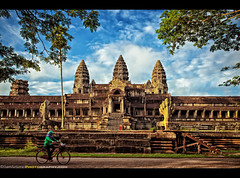 Off to the Side in Angkor Wat Temple, Siem Reap Province, Cambodia (Sam Antonio Photography) Tags: world old travel trees sky panorama sculpture cloud sun holiday reflection building tree brick tower art heritage tourism monument bicycle rock stone architecture sunrise asian religious temple site ancient worship asia cambodia southeastasia cambodian khmer exterior cloudy buddha famous religion tomb decoration ruin culture murals buddhism landmark angkorwat medieval palm historic unesco jungle reap tropical thom civilization wisdom angkor wat sideview hinduism archeology vacations raider uniqueview photographytips cambodiatravel canoneos5dmarkii samantoniophotography photographingangkorwat avoidingcrowds angkorwatphototips
