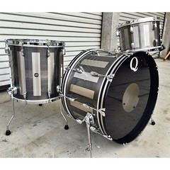 Now I know I posted this drum set from the NAMM show last week, but I couldn't resist posting it again. Stainless steel with a gunmetal patina and brushed rectangles. COB single flange hoops. Stainless has never sounded so good!! You can see it, feel it a