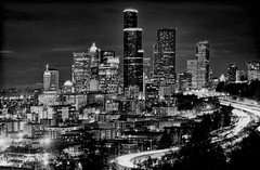 The skyline of Seattle, Washington, The Emerald City (Lago Tanganyika) Tags: seattle longexposure urban blackandwhite usa building tower skyline architecture skyscraper washington cosmopolitan downtown cityscape realestate metro monochromatic citylights highrise pacificnorthwest metropolis residential brilliant metropolitan emeraldcity density centralbusinessdistrict commercialproperty jorgemolina nikond7100