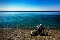 Fishing (Melissa Maples) Tags: cameraphone blue sea summer man beach apple water turkey fishing fisherman asia mediterranean trkiye antalya turk iphone angler  iphone6 konyaaltzero