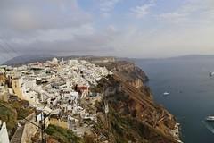 Santorini (lemonteajunkie) Tags: ocean cruise blue houses sea cliff white water island greek coast boat town europe mediterranean village view yacht horizon santorini greece shore overlooking precipice thira fira