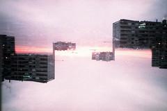 film (La fille renne) Tags: city sunset sky sun film analog 35mm buildings xpro lomography cityscape doubleexposure lomolca multipleexposure crossprocessing agfa mx agfactprecisa100 splitzer lafillerenne
