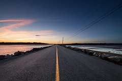 Sunset Road (J_Longmire) Tags: road pink blue sunset detail novascotia pavement asphalt causeway blacktop yellowline centerline leadingline jlongmirephotography