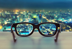Night cityscape focused in glasses lenses (caprightmarketing) Tags: life city urban black blur reflection eye beauty sunglasses night lens table lights glasses see evening town still focus looking view blurredlights watch perspective lifestyle optical style wear plastic clear vision health citylights howto nightlife sight eyeglasses viewpoint protection beautifuleyes cityatnight magnify magnifier cataract glaucoma eyewear eyesight loupe optic accessory correction nightcity urbancity