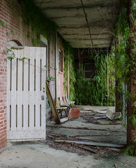 Patient Porch (FWDPhotography) Tags: door abandoned nature overgrown hospital photography photo nikon photographer chairs decay urbandecay alabama explore urbanexploration porch derelict flick overgrowth urbex d5100