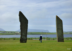 Jeffery Dwarfed By Standing Stones (orquil) Tags: uk greatbritain summer sun man silhouette june standing person islands scotland interesting orkney stenness adult stones background sunny historic massive huge unusual loch visitor monolith cloudscape impressive dwarfed neolithic stonecircle megalith enormous standingstone jeffery menhir standingstonesofstenness visitorattraction orcades hoyhills